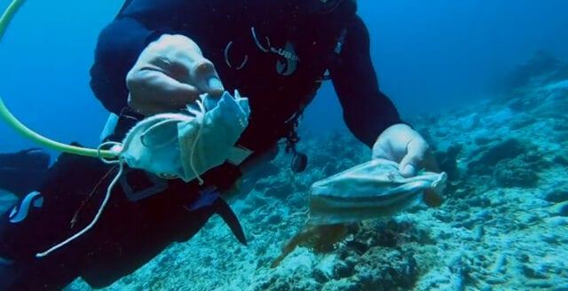 Korallrev utanför Filippinerna täckt av gamla munskydd
